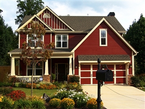HGTV2502658-RMS_front-yard-dark-red-house-djames_s4x3_lg